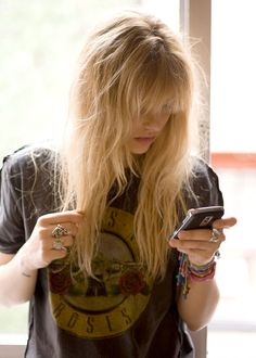 the rock & roller's just-got-out-of-bed look...i am quite familiar with this! messy hair with bangs, vintage guns n' roses tee and plenty of bracelets and rings.