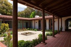 modern adobe houses   Above: The family's Jack Russell terrier sits on a terracotta door ...