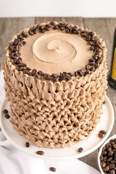 This pretty Kahlua Cake is infused with coffee liqueur & espresso, and adorned with billowy mocha buttercream ruffles.