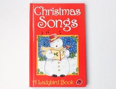 Lovely vintage Ladybird Book of Christmas Songs book - this is a First Edition published in 1988 in Series 8818, their Christmas books.  This