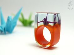 A tiny origami crane for your finger
