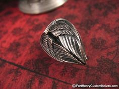 This is a custom Arch Angel Wings Bead by Derrick Obatake of Steel Flame.