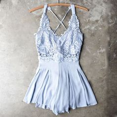 Lace accent bodice with strappy tie back romper.
