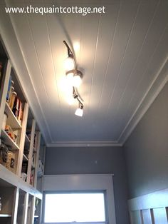 I love this planked ceiling done with sheets of paneling nailed to the joists.  Edges finished with 1 x 4 against the ceiling edges and 1 x 2 against the wall edges.  Seems like cheapest and easiest method to cover ugly popcorn ceilings!