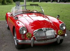 Cherry MG...So cute!  I think this is the same kind of car as in Ferris Bueller.