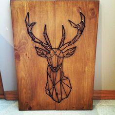Geometric deer string art sign