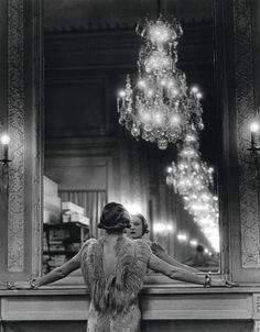 "Alfred Eisenstaedt, (1898-1995) ""Model Looking in the Mirror of Fashion Designer Molineux, Paris."""