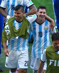 Sergio Aguero (L) and Lionel Messi of Argentina react while walking off the field after defeating Iran 1-0 during the 2014 FIFA World Cup Br...