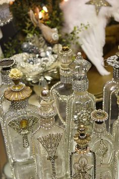 Romancing the Home: One of a Kind Christmas Gifts - embellished antique bottles.