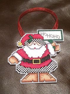 This handmade cross stitch Christmas ornament would be a beautiful addition to your tree or make a great gift. Hand stitched on plastic canvas with