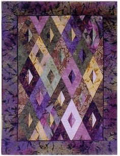 """Elongated Diamond - An original design by Jan Krueger using a slightly different angle created with the """"Tri-Recs"""" ruler. A fool the eye concept, slightly contemporary look. Some quilting experience required. Batik Quilts, Scrappy Quilts, Easy Quilts, Small Quilts, Bed Quilts, Jelly Roll Quilt Patterns, Patchwork Patterns, Quilting Projects, Quilting Designs"""