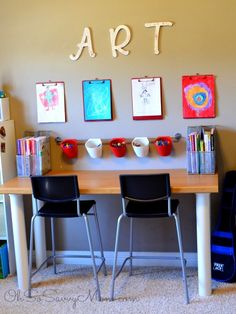 Create a colorful and fun DIY Kids Art Wall. This inexpensive art area allows you to display your kids' favorite artwork!
