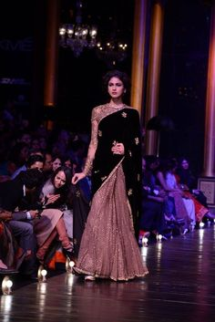 sabyasachi mukherjee half and half velvet saree.