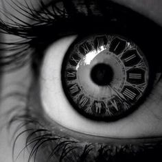 """Contact lenses with an image of an analog clock with Roman numerals. Via @Mel Haskins on Twitter: """"@ScottWesterfeld Reminded me of Uglies. (I need to find some of these! So cool.)"""""""