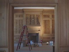 Pecky cypress paneling- yes please! Fireplace Surrounds, Fireplace Mantels, Fireplaces, Fireplace Ideas, Pecky Cypress Paneling, Kitchen Hearth Room, Acadian Homes, Wainscoting Panels, White Oak Floors