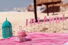 cute idea for a 1st birthday! cake smash on the beach, pink ombre rose birthday cake