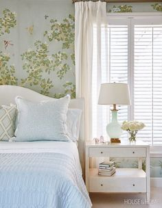 The linens and grasscloth-covered dresser offset the richness of the principal bedroom's wallpaper. | Photographer: Stacey Brandford | Designer: Sarah Richardson and Kate Stuart, Sarah Richardson Design
