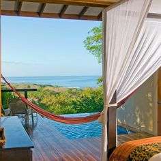 Casa Chameleon Hotel Mal Pais Mal Pais, Costa Rica Adult-only Balcony Bedroom Country Eco Jungle Romantic Rustic Scenic views Suite leisure property bed room Resort Villa interior design home cottage swimming pool porch furniture overlooking Deck