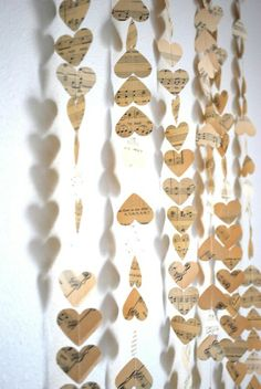 Hearts cut out of old music sheets, sew together with fishing line, etc.