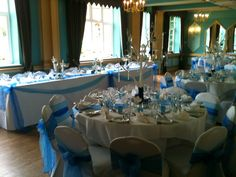 white stretch covers with royal blue & turquoise double sash