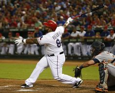 Texas Rangers' Prince Fielder follows through on his RBI single against the Detroit Tigers during the third inning of a baseball game, Wednesday, September 30, 2015, at Globe Life Park in Arlington, Texas.