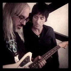 Johnny Marr and J. Mascis, playing with Marr's signature Fender Jaguar guitar.