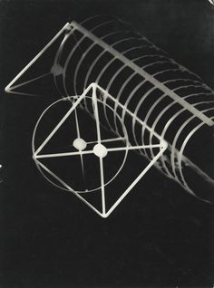 László Moholy-Nagy 1895-1946 FOTOGRAMM (PHOTOGRAM WITH DIAGRAMMATIC SQUARE AND CIRCLES) photogram, a unique object, signed 'Moholy = Nagy,' titled, dated, inscribed 'ich bitte das foto eiligst zurück dessau, burgkühnauer allee 2'  1925 9 3/8  by 7 in. (23.7 by 17.7 cm.)
