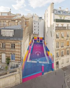 Ill-Studio and Pigalle have returned to a basketball court they previously overhauled with bold patterns, replacing primary colours with gradients of blue, pink, purple and orange.