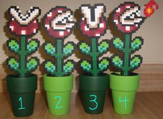 8 bit Super Mario Bros Piranha Plants in Pipes (Individual). $12.00, via Etsy.  What a cool thing to do with melty beads!