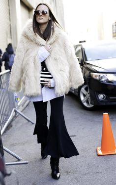 White fur coat + extreme flares | Street Style from New York Fashion Week Fall 2016 @stylecaster