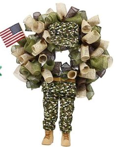 """Soldier Decor Kit Hat & Legs Size: 19"""" overall length Color: Camo Hat and legs Material: Polyester, Wire Additional image shows how product could be used on a wreath. Image is provided by suppliers, size is unknown, other items not included."""
