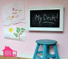 This do it yourself kids desk folds up to become a wall chalkboard! Stores art supplies and even a paper roll holder! Super easy step by step instructions to DIY your own!