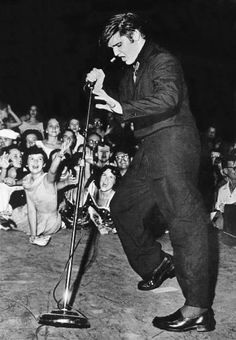 Elvis Presley performs for 14,000 fans at Russwood Park in Memphis the night of July 4, 1956. (SHNS file photo by Robert Williams / The Commercial Appeal)