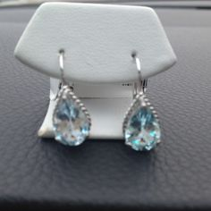 Tier Drop Topaz earrings These sky blue topaz tier drop earring are sizely and clean. Never been worn. Jewelry Earrings