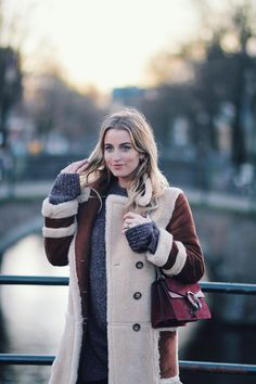 A LONG COAT TO KEEP | Asos shearling maxi coat, Weekday oversized sweater, black skinny jeans, Gucci Dionysus bag, Amsterdam fashion blogger | Queen of Jet Lags