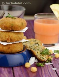 Anybody is game to feast on tikkis at just about any hour of the day! Such is the appetizing power of this aromatic and tasty snack. If you thought plain potato tikkis are toothsome enough, you will just go ga-ga over this enhanced version that includes white chickpeas, soya granules and garlic paste as some of the key ingredients along with flavourful additions like mint leaves and onions too. A dash of lemon juice, though small in quantity, is essential to boost the flavours of the other…