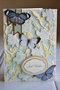 Anna Griffin cutting dies:  Cut two of the same die, ink one green, the other blue.  Layer the green image on the bottom.  Cut out blue flowers, adhere them over green layer with pop dots.