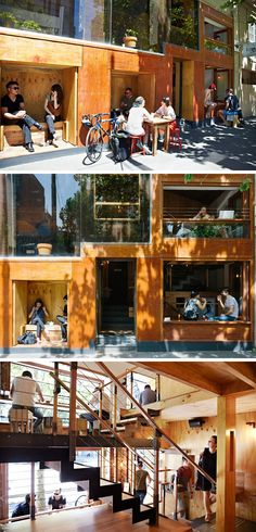 This modern cafe has built-in wooden seating nooks on the outside of the cafe, while inside, people sit at bars looking out onto the street.