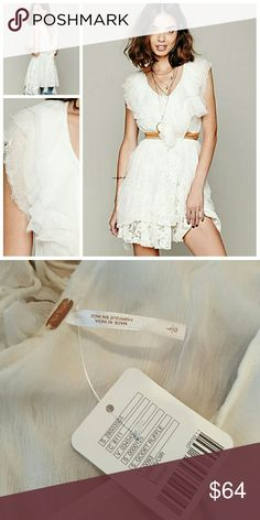 "Free People Godet Ruffle Off-white sheer chiffon ruffled tunic with deep ""V"" neckline in the front. Stretchy waist. Ruffle trimming around the neckline and vertically around the bottom portion. Bottom portion has embroidered mesh inserts. Deep ""V"" drop back with ties at the upper back.   *100% Nylon *Machine Wash Cold Free People Tops Tunics"