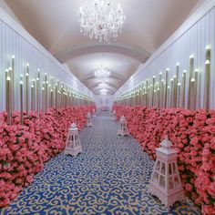 Hundreds of cube lights and flickering candle lanterns created a dazzling effect in the long, rose garden-lined hallway leading to the ceremony venue. #lightingeffects #modernwedding #wedding2016 #weddingflowers #weddinglighting #weddinghall #weddingideas #nasheedevents