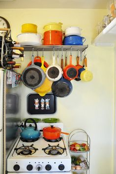 Easy shelf to install - hang hooks and bam! There's your pots and pans! (And whoever has this many Le Creuset pots and pans can probably afford a bigger apartment than this!)