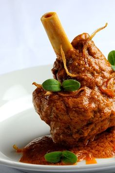 A slow-cooked Lamb Shanks recipe from Indian born chef, Alfred Prasad, is given fragrance by an infusion of Indian spices Roasted Lamb Shanks, Slow Cooked Lamb Shanks, Braised Lamb Shanks, Goat Recipes, Lamb Chop Recipes, Indian Food Recipes, Cooking Recipes, Veg Recipes, Roast Lamb Shank Recipe