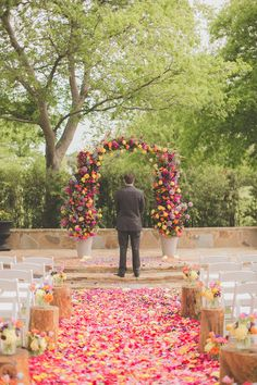 Amazing petal-strewn aisle and floral altar (via Birds of a Feather Events)