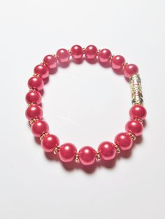 Stretchy bracelet made with pink 6mm beads