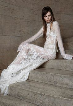 Vera Wang Spring 2015 Bridal Collection - Ivory Chantilly lace shirtwaist gown with hand appliqué corded lace. Hand embroidered pearl and crystal grosgrain belt.