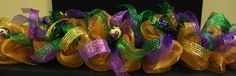 I never would of thought to decorate my mantel for the party. Great Idea!!!!!!!!!!!!!!! Mardi Gras Garland Mardi Gras Deco Poly Mesh by wreathsbyrobin, $85.00