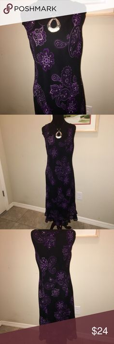 Beautiful Sleeveless Dress with Ruffle Bottom SZ10 80% Rayon 20% Nylon lightweight lined black dress with beautiful purple pattern. Ruffle along bottom, sleeveless, pullover dress. Size 10, like new!! No flaws! Gorgeous addition to your summer wardrobe! Studio I Dresses