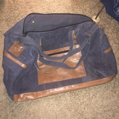 Weekend Bag Tote Sturdy canvas recycled material, tan pocket accents, carry handles as well as shoulder strap, 5 bottom peg feet, 3 pockets outside, and 3 pockets inside, environmentally happy, great dark gray color. New without tags, never used!!! Mona B. Bags Travel Bags