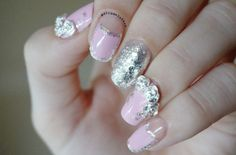 http://themakeuphoneyblog.com/2014/11/08/pink-nails-with-silver-roses/