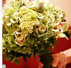 Green cymbidium orchids, hydrangeas, cockscomb, and hypericum berries gave Lisa's bouquet a rustic look.